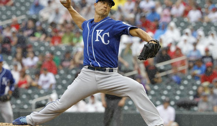 Kansas City Royals starting pitcher Jeremy Guthrie delivers to the Minnesota Twins during the fourth inning of a baseball game in Minneapolis, Sunday, Aug. 17, 2014. (AP Photo/Ann Heisenfelt)