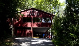 "FOR RELEASE SUNDAY, AUGUST 17, 2014, AT 9:00 A.M. EDT - In this Aug. 4, 2014 photo, visitors enter the building which houses the long path that leads to the entrance of Grand Caverns in Grottoes, Va  From the Shenandoah Valley to the Cumberland Gap, from Luray Caverns to Dixie Caverns, these ""show caves"" all have their own distinct features that set them apart from one another.  (AP Photo/The Roanoke Times, Stephanie Klein-Davis)  LOCAL TELEVISION OUT; SALEM TIMES REGISTER OUT; FINCASTLE HERALD OUT;  CHRISTIANBURG NEWS MESSENGER OUT; RADFORD NEWS JOURNAL OUT; ROANOKE STAR SENTINEL OUT"