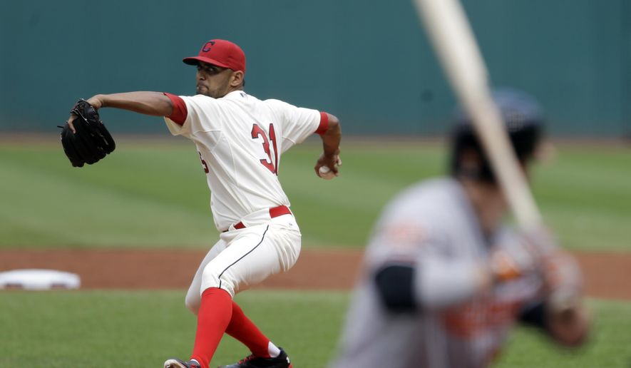 Cleveland Indians starting pitcher Danny Salazar, left, delivers to Baltimore Orioles' Steve Pearce in the first inning of a baseball game, Sunday, Aug. 17, 2014, in Cleveland. (AP Photo/Tony Dejak)