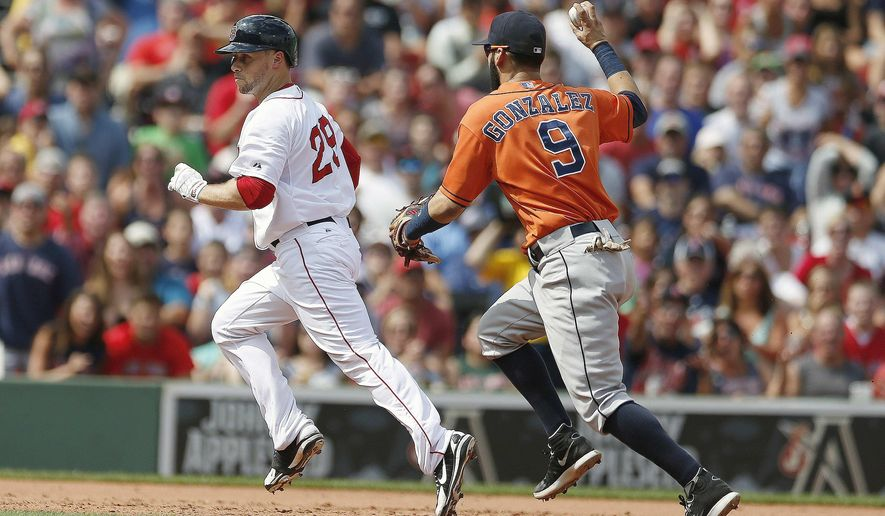 Houston Astros' Marwin Gonzalez (9) pursues Boston Red Sox's Daniel Nava in a rundown at second base after he tried to stretch a double during the third inning of a baseball game in Boston, Sunday, Aug. 17, 2014. (AP Photo/Michael Dwyer)