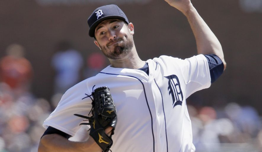 Detroit Tigers pitcher Robbie Ray delivers against the Seattle Mariners during the first inning of a baseball game on Sunday, Aug. 17, 2014, in Detroit. (AP Photo/Duane Burleson)