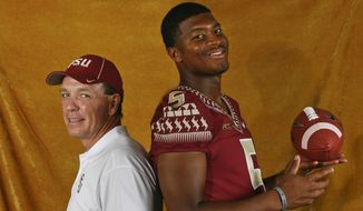 Florida State head coach Jimbo Fisher, left, and quarterback Jameis Winston (5) pose for a photo during their NCAA college football media day on Sunday, Aug. 10, 2014, in Tallahassee, Fla. Florida State starts its quest for back-to-back national championships Aug. 30 when they open against Oklahoma State in Arlington, Tex. (AP Photo/Phil Sears)