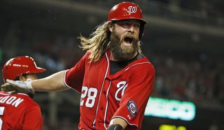 Washington Nationals right fielder Jayson Werth celebrates after scoring the winning run in a baseball game against the Pittsburgh Pirates, Sunday, Aug. 17, 2014, in Washington. The Nationals won 6-5 in 11 innings. (AP Photo/Alex Brandon)