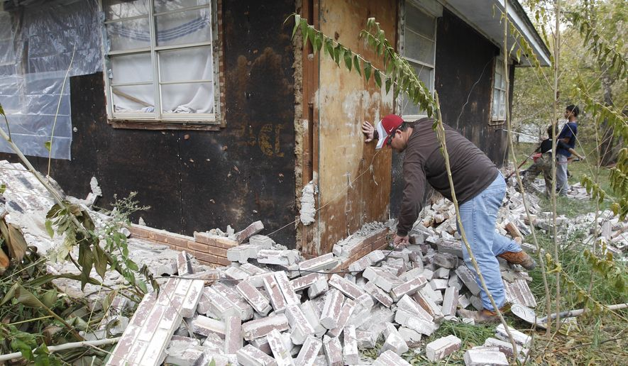 FILE - This Nov. 6, 2011 file photo shows earthquake damage in Sparks, Okla. on Sunday, Nov. 6, 2011 after two earthquakes hit the area in less than 24 hours. Man-made earthquakes, a side effect of some high-tech energy drilling, cause less shaking and in general are about 16 times weaker than natural earthquakes with the same magnitude, a new federal study found. People feeling the ground move from induced quakes _ those that are not natural, but triggered by injections of wastewater deep underground_ report significantly less shaking than those who experience more normal earthquakes of the same magnitude, according to a study by U.S. Geological Survey geophysicist Susan Hough. However within 6 miles of the fault, artificial and natural quakes feel pretty much the same, she said. (AP Photo/Sue Ogrocki, File)