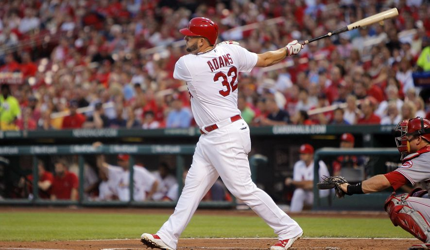 St. Louis Cardinals' Matt Adams hits an RBI double during the first inning of a baseball game against the Cincinnati Reds, Monday, Aug. 18, 2014, in St. Louis. (AP Photo/Scott Kane)