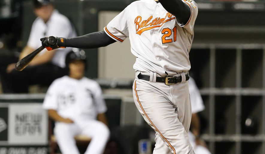 Baltimore Orioles' Nick Markakis watches his two-run home run off Chicago White Sox relief pitcher Matt Lindstrom, also scoring Jonathan Schoop, during the eighth inning of a baseball game Monday, Aug. 18, 2014, in Chicago. (AP Photo/Charles Rex Arbogast)