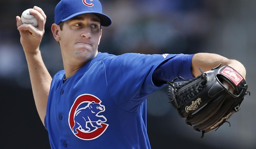 Chicago Cubs starting pitcher Kyle Hendricks  delivers in a baseball game against the New York Mets at Citi Field in New York, Monday, Aug. 18, 2014. (AP Photo/Kathy Willens)