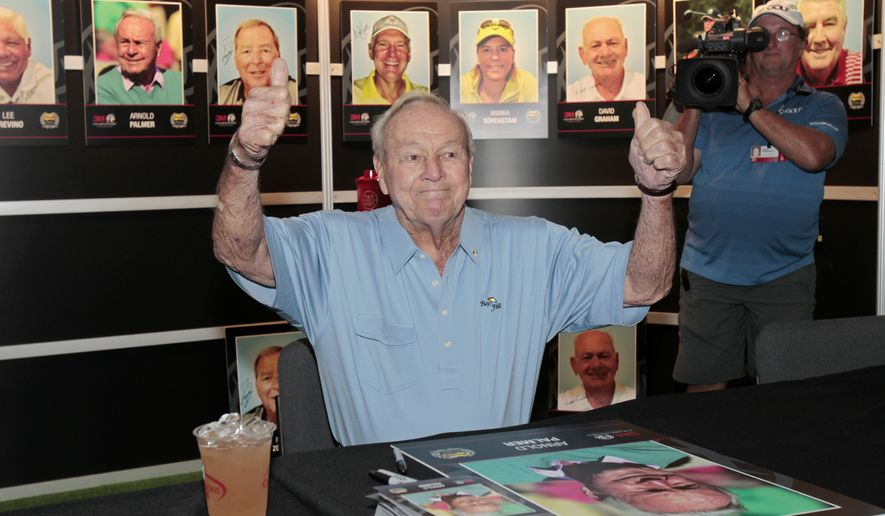 Arnold Palmer gives the thumbs up as he signs autographs before the second round of the Champions Tour's 3M Championship golf tournament at TPC Twin Cities in Blaine, Minn., Saturday, Aug. 2, 2014. (AP Photo/Paul Battaglia)