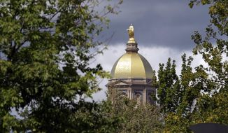 """The """"Golden Dome"""" of the administration building is shown before the start of the Notre Dame/against the Purdue college football game in South Bend, Ind., Saturday, Sept. 8, 2012. (AP Photo/Michael Conroy)"""