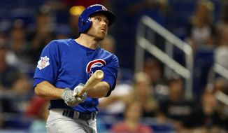 Chicago Cubs's Nate Schierholtz watches his ball as he hits a 3-run home run during the sixth inning of a baseball game against the Miami Marlins in Miami, Wednesday, June 18, 2014.  (AP Photo/J Pat Carter)