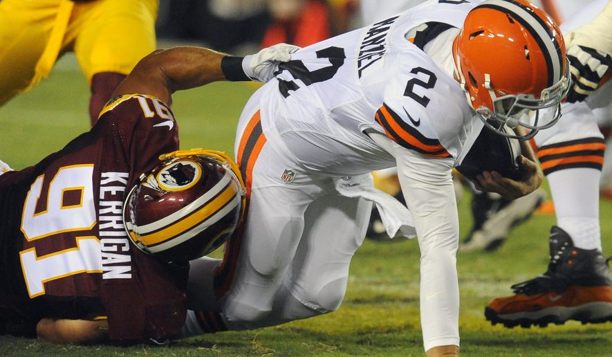 Washington Redskins outside linebacker Ryan Kerrigan (91) sacks Cleveland Browns quarterback Johnny Manziel (2) during the first half of an NFL preseason football game Monday, Aug. 18, 2014, in Landover, Md. (AP Photo/Richard Lipski)
