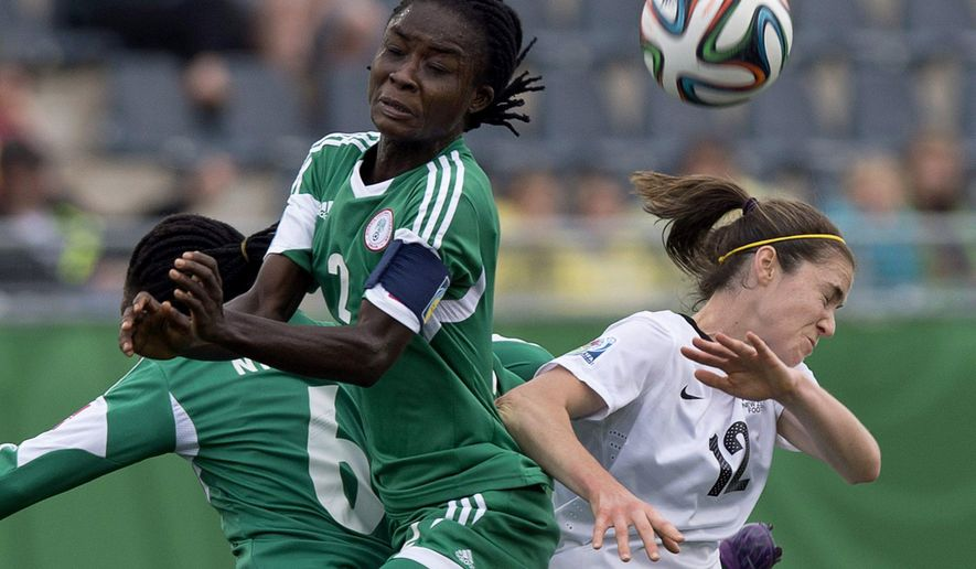 New Zealand's Steph Skilton, right, battles Nigeria's Ebere Okoye in FIFA U20 Women's World Cup quarter-final action in Moncton, New Brunswick,. Sunday, Aug. 17, 2014. Nigeria won 4-1. (AP Photo/The Canadian Press, Andrew Vaughan)