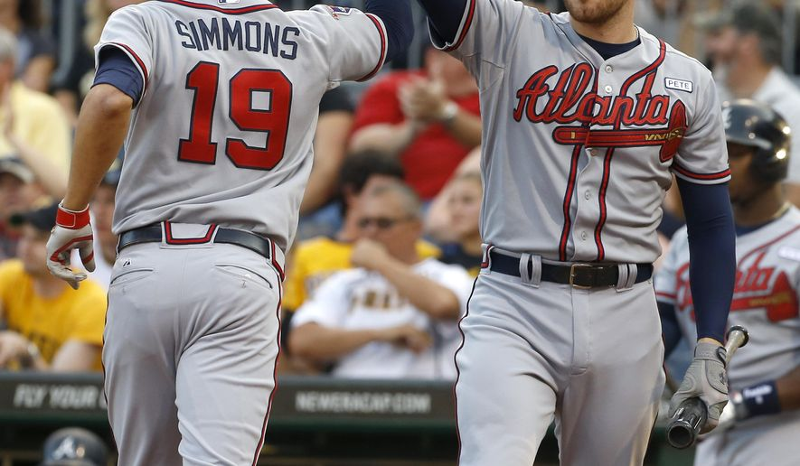 Atlanta Braves' Andrelton Simmons is greeted by on deck batter Freddie Freeman after hitting a solo home run in the first inning of the baseball game against the Pittsburgh Pirates on Monday, Aug. 18, 2014, in Pittsburgh. (AP Photo/Keith Srakocic)