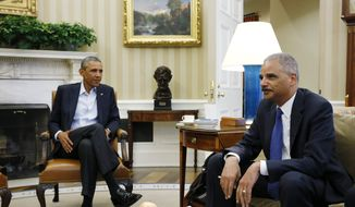 President Barack Obama speaks with Attorney General Eric Holder as news photographers photograph their meeting regarding the fatal police shooting of a black teenager in Ferguson, Missouri, Monday, Aug. 18, 2014, in the Oval Office of the White House in Washington. (AP Photo/Charles Dharapak)