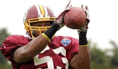 Washington Redskins NFL football team's  Darryl Sharpton (53) catches a pass during a team practice with the New England Patriots in Richmond, Va., Monday, Aug. 4, 2014. (AP Photo/Jay Paul)
