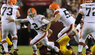 Cleveland Browns quarterback Johnny Manziel (2) is sacked by Washington Redskins outside linebacker Ryan Kerrigan (91) in the first quarter at FedEx Field, Aug. 18, 2014. (Preston Keres/Special for The Washington Times)