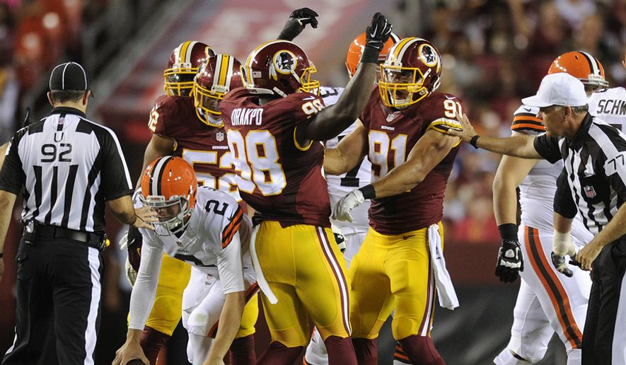 Washington Redskins outside linebacker Brian Orakpo (98) celebrates outside linebacker Ryan Kerrigan's (91) sack of Cleveland Browns quarterback Johnny Manziel (2)  at FedEx Field, Aug. 18, 2014. (Preston Keres/Special for The Washington Times)