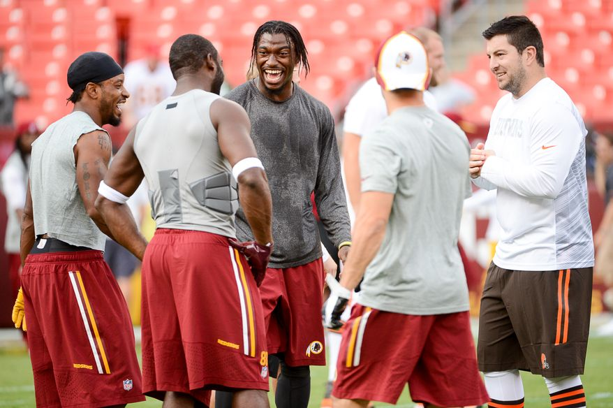 Left to right: Washington Redskins wide receivers Santana Moss (89), and Pierre Garcon (88), Washington Redskins quarterback Robert Griffin III (10), talk with former Washington Redskins quarterback and current Cleveland Browns quarterback Rex Grossman (3), right, before the Washington Redskins play the Cleveland Browns in NFL preseason football at FedExField, Landover, Md., Monday, August 18, 2014. (Andrew Harnik/The Washington Times)