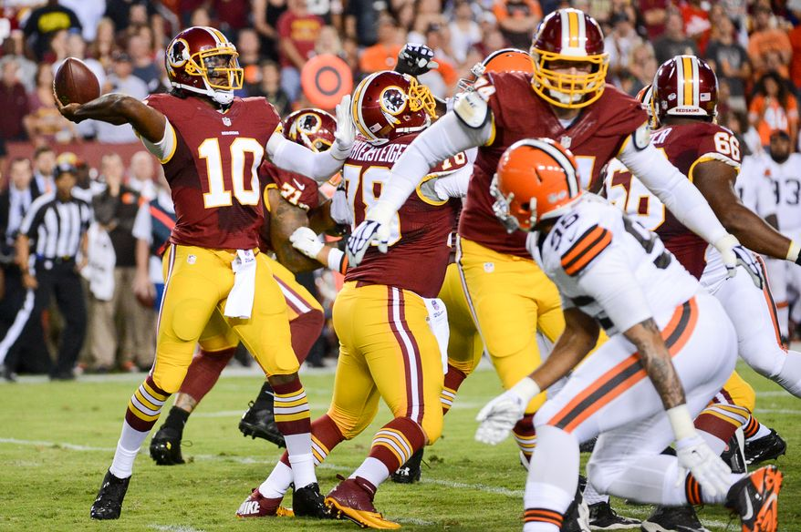 Washington Redskins quarterback Robert Griffin III (10) passes in the first quarter as the Washington Redskins play the Cleveland Browns in NFL preseason football at FedExField, Landover, Md., Monday, August 18, 2014. (Andrew Harnik/The Washington Times)