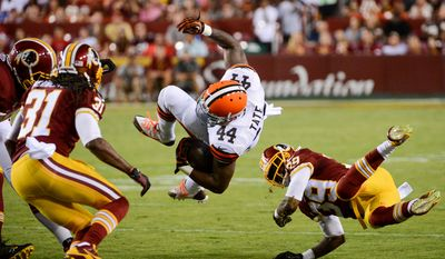 Cleveland Browns running back Ben Tate (44) is tackled by Washington Redskins free safety David Amerson (39) in the first quarter as the Washington Redskins play the Cleveland Browns in NFL preseason football at FedExField, Landover, Md., Monday, August 18, 2014. (Andrew Harnik/The Washington Times)