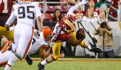 Cleveland Browns outside linebacker Paul Kruger (99) sacks Washington Redskins quarterback Robert Griffin III (10) in the first quarter as the Washington Redskins play the Cleveland Browns in NFL preseason football at FedExField, Landover, Md., Monday, August 18, 2014. (Andrew Harnik/The Washington Times)