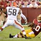 Washington Redskins quarterback Robert Griffin III (10) slides after running for a gain in the first quarter as the Washington Redskins play the Cleveland Browns in NFL preseason football at FedExField, Landover, Md., Monday, August 18, 2014. (Andrew Harnik/The Washington Times)