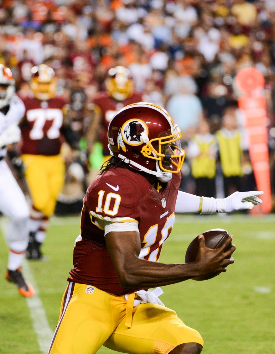 Washington Redskins quarterback Robert Griffin III (10) scrambles in the first quarter as the Washington Redskins play the Cleveland Browns in NFL preseason football at FedExField, Landover, Md., Monday, August 18, 2014. (Andrew Harnik/The Washington Times)