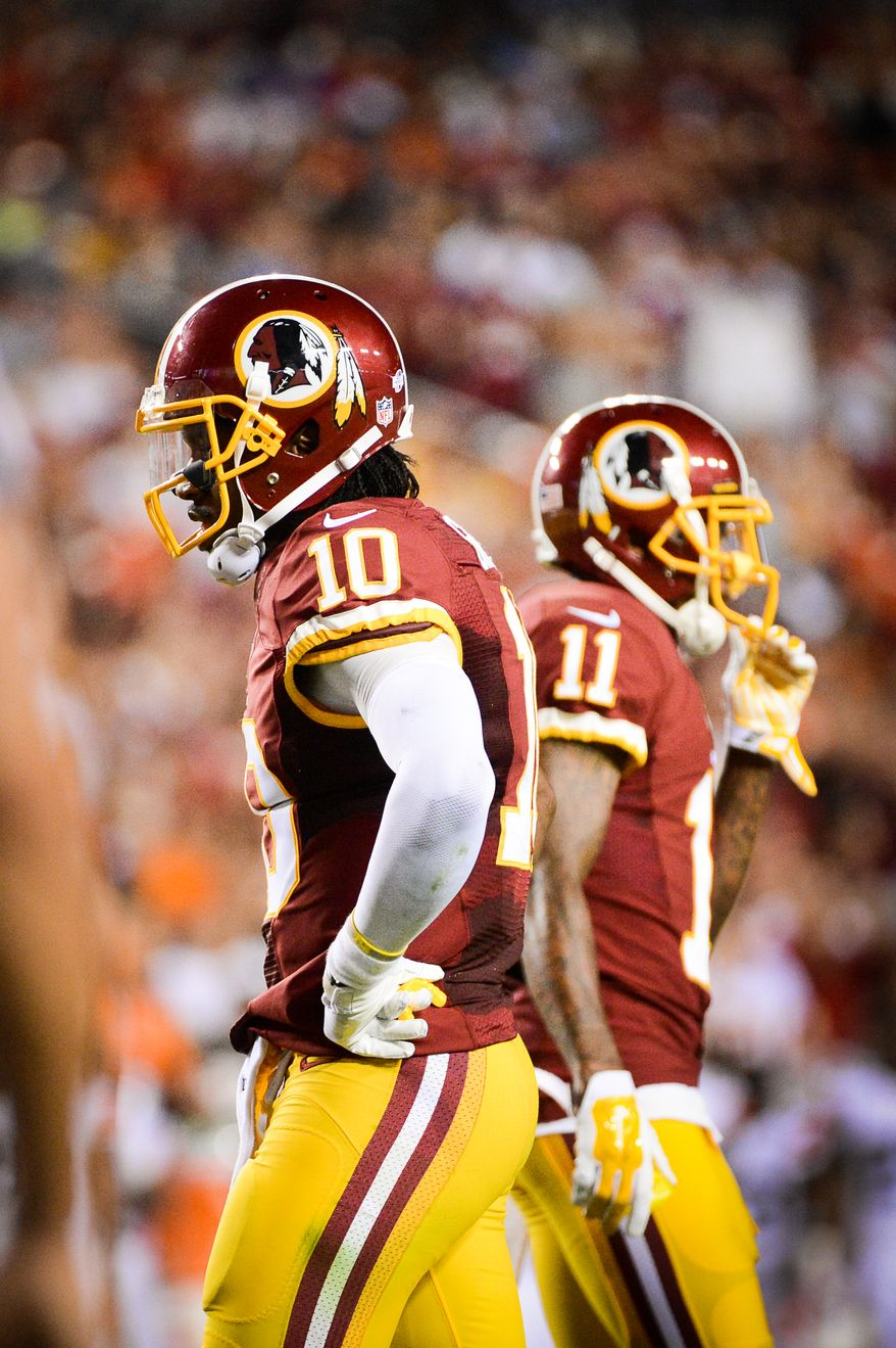 Washington Redskins quarterback Robert Griffin III (10) and Washington Redskins wide receiver DeSean Jackson (11) between plays in the second quarter as the Washington Redskins play the Cleveland Browns in NFL preseason football at FedExField, Landover, Md., Monday, August 18, 2014. (Andrew Harnik/The Washington Times)