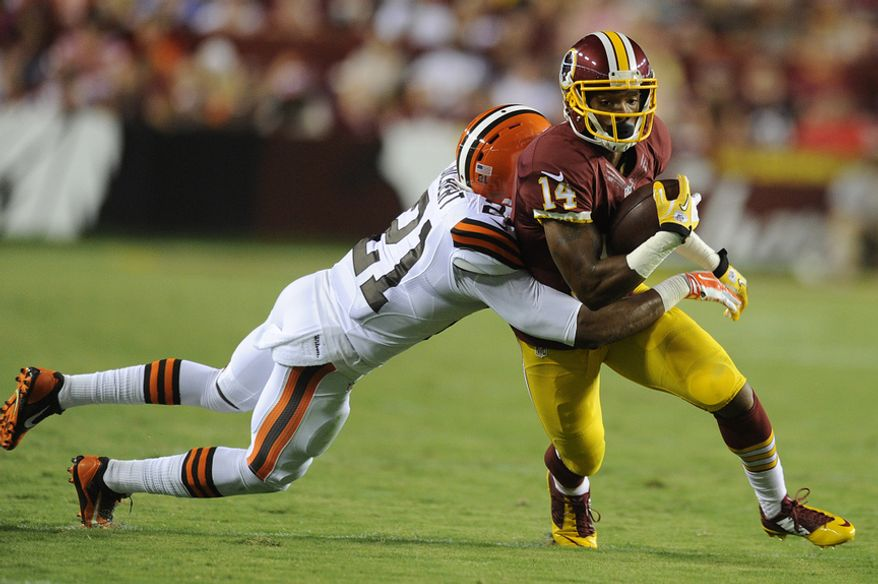 Washington Redskins wide receiver Ryan Grant (14) turns upfield against Cleveland Browns cornerback Justin Gilbert (21) for a second quarter first down reception at FedEx Field, Aug. 18, 2014. (Preston Keres/Special for The Washington Times)