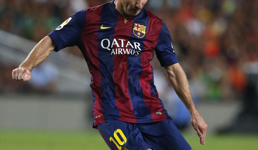 Barcelona's Lionel Messi, from Argentina, kicks the ball during the Joan Gamper trophy friendly soccer match between Barcelona and Leon at the Camp Nou stadium in Barcelona, Spain, Monday, Aug. 18, 2014. (AP Photo/Emilio Morenatti)