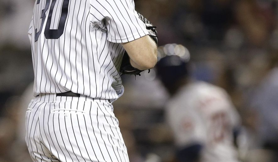 New York Yankees relief pitcher David Robertson (30) waits as Houston Astros' Chris Carter runs the bases after hitting a three-run home run during the ninth inning of a baseball game Tuesday, Aug. 19, 2014, in New York. (AP Photo/Frank Franklin II)