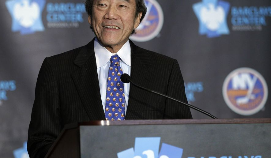 "FILE - This is an Oct. 24, 2012, file photo,  showing New York Islanders owner Charles Wang addressing the media during a press conference at Brooklyn's Barclays Center. The New York Islanders have announced that the team is being sold to a former Washington Capitals co-owner and a London-based investor. In a statement Tuesday, Aug. 19, 2014, the team says a group led by former Capitals co-owner Jon Ledecky and investor Scott Malkin has reached an agreement to buy a ""substantial"" minority interest in the team. (AP Photo/Kathy Willens, File)"
