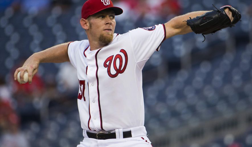 Washington Nationals starter Stephen Strasburg delivers a pitch during the first inning of a baseball game against the Arizona Diamondbacks on Tuesday, Aug. 19, 2014, in Washington. (AP Photo/Evan Vucci)