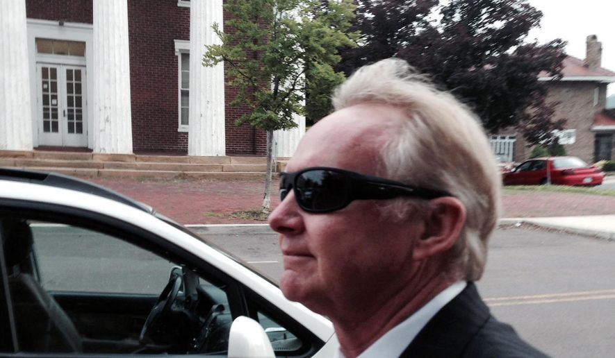 FILE - In this June 10, 2014, file photo, Dr. William Dando walks outside the Allegany County Courthouse in Cumberland, Md. A West Virginia woman is suing Dando for more than $1.5 million, alleging he sexually assaulted her at a walk-in clinic in western Maryland. The lawsuit filed in Allegany County Circuit Court also names Dando's former employer, MedExpress Urgent Care, of Morgantown, West Virginia. It alleges the company knew, or should have known, about Dando's 1987 conviction for a Florida rape. The Maryland Board of Physicians suspended Dando's license in June after he was charged with molesting another woman at the clinic in LaVale. He denies those charges.(AP Photo/David Dishneau, File)