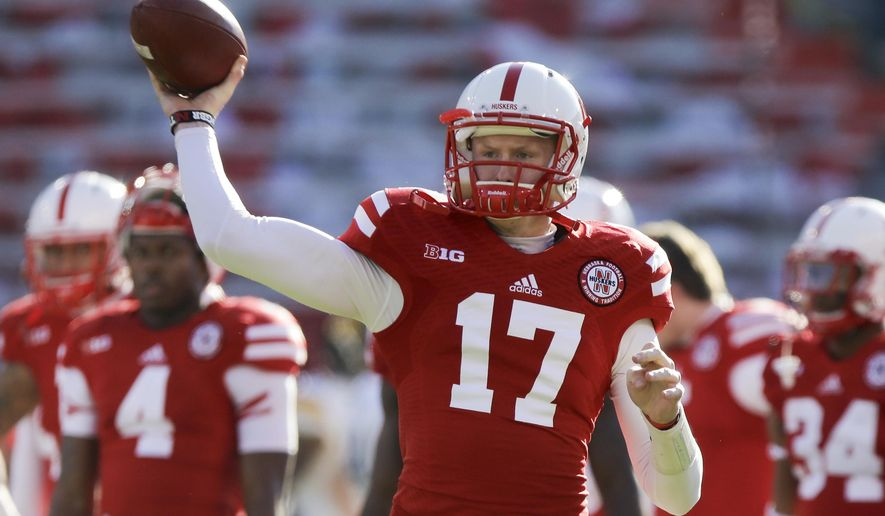 FILE - In this Nov. 29, 2013, file photo, Nebraska quarterback Ryker Fyfe (17) throws during warmups as Iowa and Nebraska prepare to square off in an NCAA college football game in Lincoln, Neb. Fyfe has used his underdog attitude to fuel his drive to the top backup quarterback's job behind Tommy Armstrong Jr. (AP Photo/Nati Harnik, File)