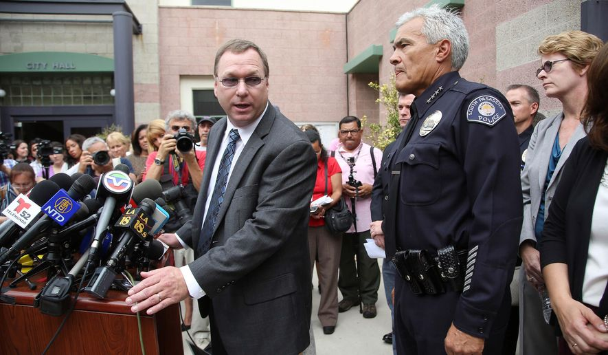 South Pasadena, Calif., police chief Arthur Miller, right, and South Pasadena Unified School District superintendent Dr. Geoff Yanz announce at a City Hall news conference Tuesday, Aug. 19, 2014, that the police has arrested two South Pasadena High School high school students suspected of planning a massacre at the school after investigators monitored their Internet activities. Miller said that school officials had heard about the plot and informed police, who determined the threat was credible. Police say the boys, ages 16 and 17, didn't have weapons but were researching automatic weapons and explosives, especially propane. (AP Photo/ Nick Ut )
