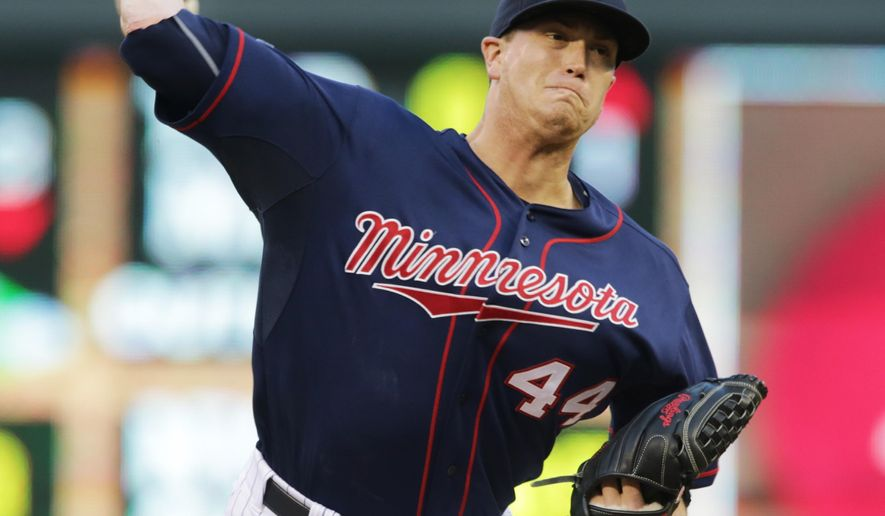 Minnesota Twins pitcher Kyle Gibson throws against the Cleveland Indians in the first inning of a baseball game, Tuesday, Aug. 19, 2014, in Minneapolis. (AP Photo/Jim Mone)