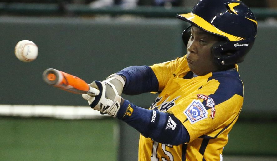 Chicago's Darion Radcliff (15) drives in a run with a single off Pearland pitcher Walter Maeker III in the fourth inning inning of an elimination baseball game at the Little League World Series in South Williamsport, Pa., Tuesday, Aug. 19, 2014. Chicago won 6-1. (AP Photo/Gene J. Puskar)