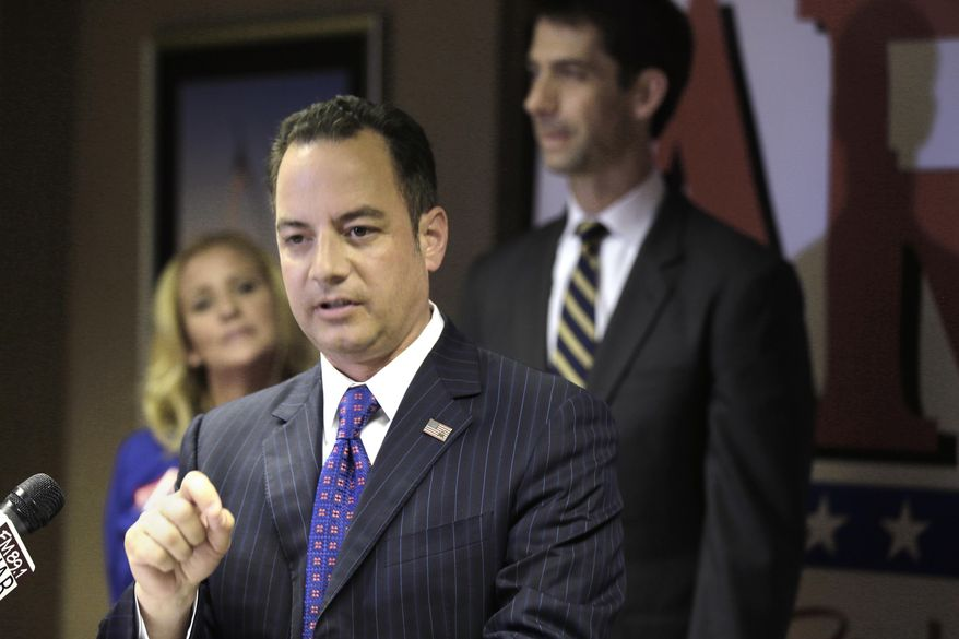 Republican National Committee Chairman Reince Priebus, center, speaks at the Republican Party of Arkansas' Victory 365 center in Little Rock, Ark., on Aug. 19, 2014, as attorney general candidate Leslie Rutledge, left, and Senate candidate and U.S. Rep. Tom Cotton, R-Ark., listen. (AP Photo/Danny Johnston) ** FILE **