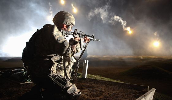 munitions: National Guard Sgt. Larry J. Isbell fires at targets with his M4A1 carbine rifle. The Army is looking to phase out the longstanding weapon, but the potential suppliers to do so, as well as the competition results, remain shrouded in secrecy. (photo by spc. venessa hernandez)