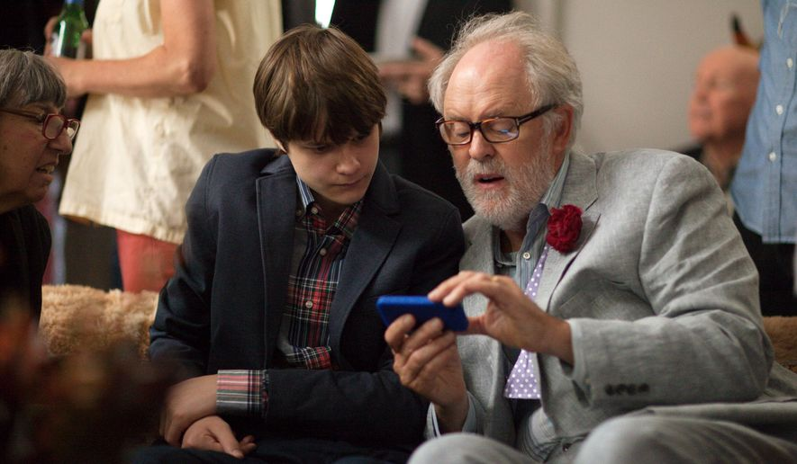 "This image released by Sony Pictures Classics shows Charlie Tahan , left, and John Lithgow in a scene from ""Love Is Strange."" (AP Photo/Sony Pictures Classics, Jeong Park)"