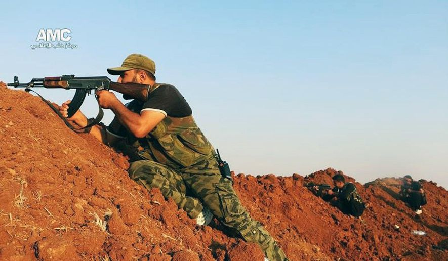 This Sunday, Aug. 17, 2014 photo provided by the anti-government activist group Aleppo Media Center (AMC), which has been authenticated based on its contents and other AP reporting, shows a Free Syrian Army fighter aiming his weapon during a battle with Islamic State militants in Aleppo, Syria. Members of the Islamic State group have been marching in the northern province of Aleppo capturing areas under the control of the mainstream Free Syrian Army. Islamic State fighters have overrun nearly a dozen towns and villages in Aleppo province last week crushing what little resistance they have encountered. (AP Photo/Aleppo Media Center AMC)