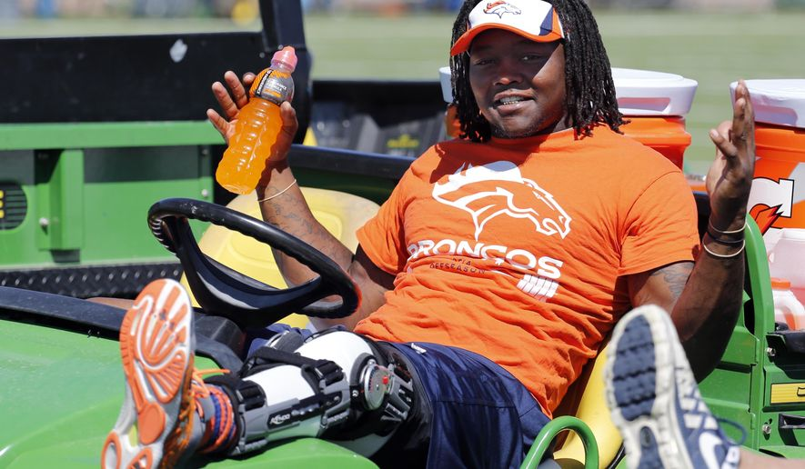 Injured Denver Broncos outside linebacker Danny Trevathan rests in a cart while watching a joint practice between the Broncos and the Houston Texans on Tuesday, Aug. 19, 2014, in Englewood, Colo. (AP Photo/Jack Dempsey)
