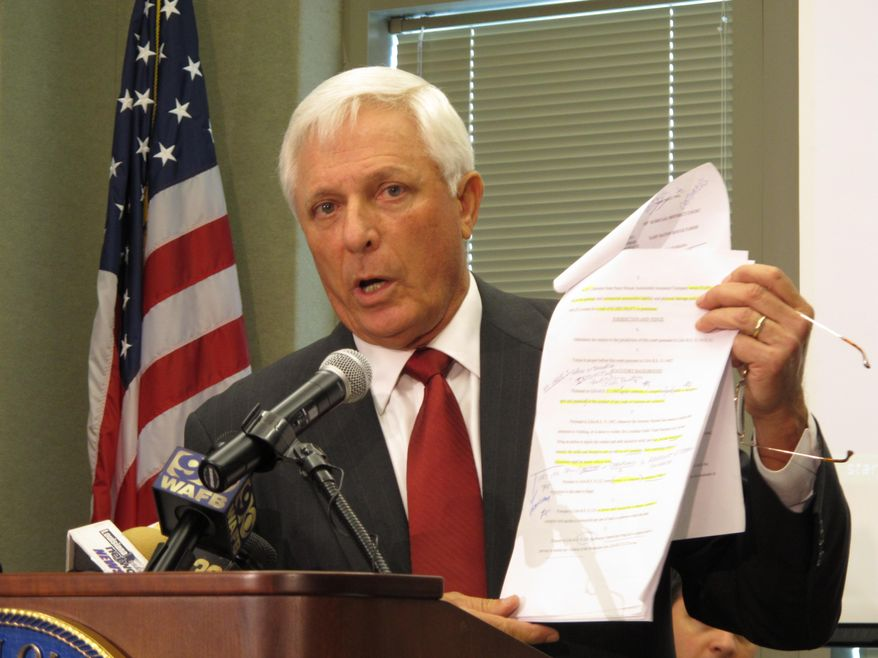 Louisiana Attorney Gen. Buddy Caldwell holds a copy of his office's lawsuit against State Farm on Tuesday, Aug. 19, 2014, in Baton Rouge, La. The lawsuit accuses the insurance company of steering customers who have been in accidents to repair shops that prioritize cheap fixes over safety. (AP Photo/Melinda Deslatte)