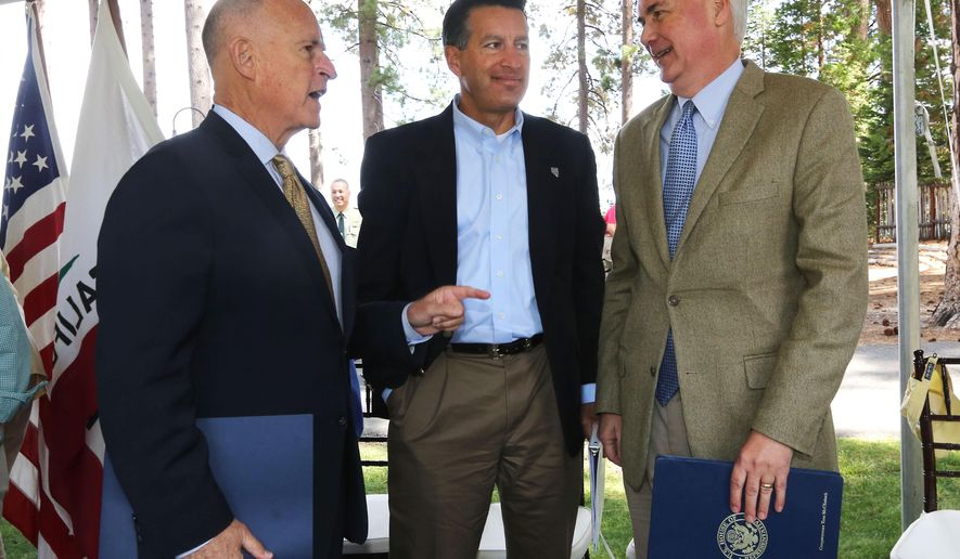 California Gov. Jerry Brown, left, talks with Nevada Gov. Brian Sandoval, center, and Rep. Tom McClintock, R-Calif., after they spoke a the 18th Annual Lake Tahoe Summit, Tuesday, Aug. 19, 2014, in South Lake Tahoe, Calif.  McClintock, whose district includes the west side of Lake Tahoe, said that money from logging could help pay for forest improvements. (AP Photo/Rich Pedroncelli)