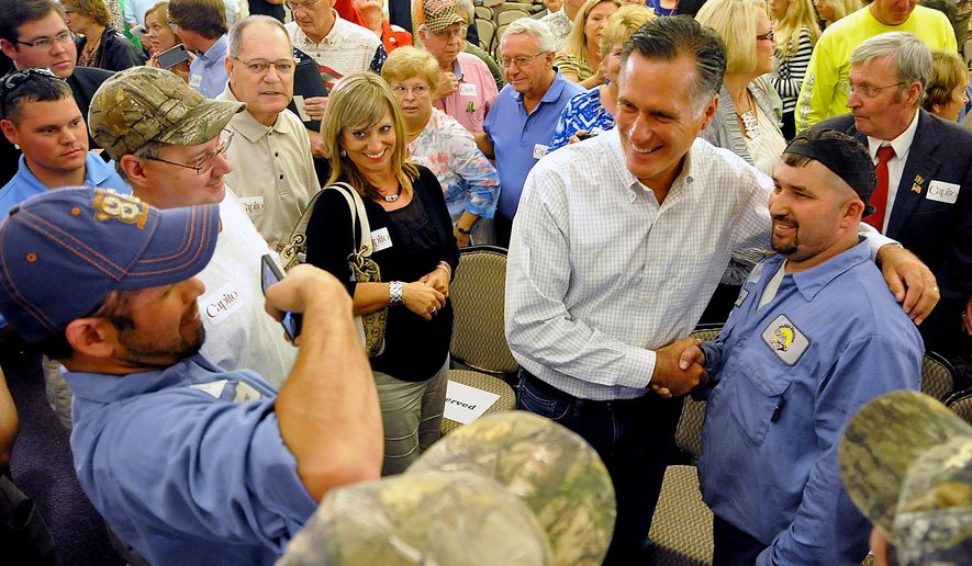 Former Massachusetts Gov. Mitt Romney takes a photo with supporter Sam Massey at Tamarack during the Working for Jobs Rally in Beckley, W.Va., Tuesday, Aug. 19, 2014. (AP Photo/Chris Tilley)