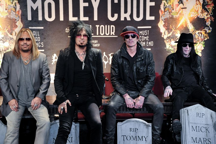 This Jan. 28, 2014 file photo shows, from left, Vince Neil, Nikki Sixx, Tommy Lee, and Mick Mars of Motley Crue at a press conference in Los Angeles. (Photo by Richard Shotwell/Invision/AP, File)