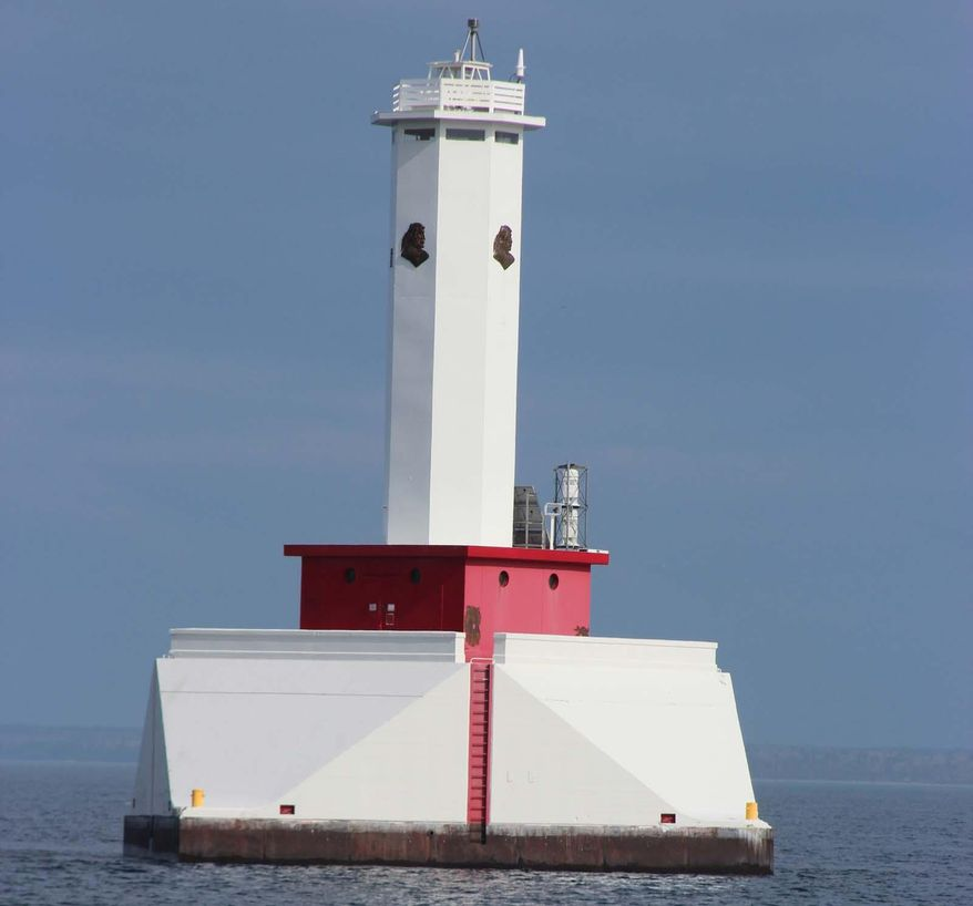 This undated photo shows the Round Island Passage Lighthouse near Mackinac Island,, Mich. The latest bid for the Round Island Passage Lighthouse was $20,000, as of Tuesday, AUg. 19, 2014. The sale began Monday with an opening bid of $10,000. The building with a 71-foot tower is on state-owned Great Lakes Public Trust bottomlands, which isn't being sold.The Round Island Passage Lighthouse opened in 1948 to mark a passage between Mackinac and Round islands in Lake Huron.(AP Photo/Detroit Free Press, Ellen Creager)  DETROIT NEWS OUT;  NO SALES, MAGS OUT, TV OUT, MANDATORY CREDIT