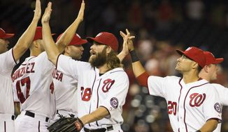 Washington Nationals' Jayson Werth, left, and Ian Desmond, right, are congratulated by teammates after the Nationals' 8-1 victory over the Arizona Diamondbacks in a baseball game at Nationals Park on Tuesday, Aug. 19, 2014, in Washington. (AP Photo/Evan Vucci)