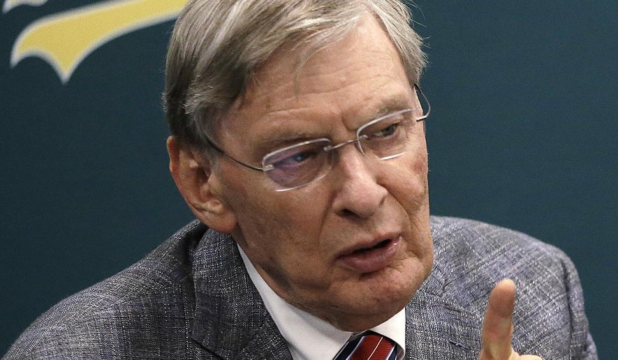 Baseball commissioner Bud Selig gestures during a news conference prior to a baseball game between the New York Mets and the Oakland Athletics on Tuesday, Aug. 19, 2014, in Oakland, Calif. (AP Photo/Ben Margot)